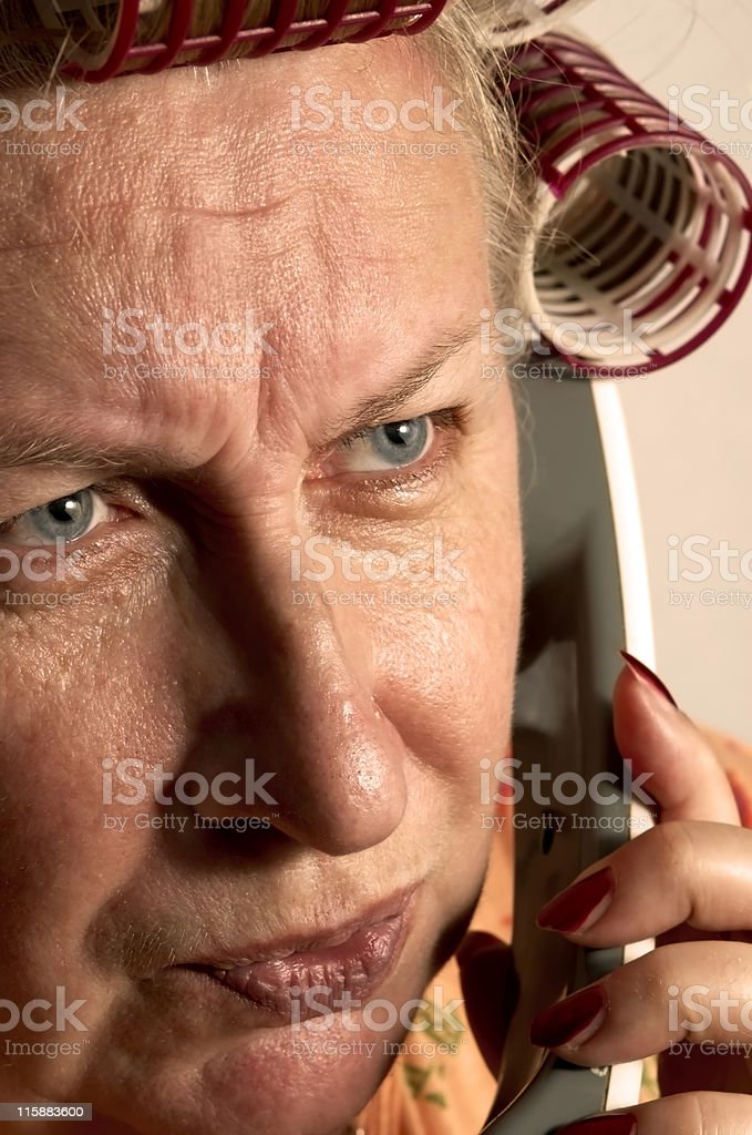 Housewife on the phone royalty-free stock photo