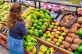 Caucasian Housewife shopping for fruit