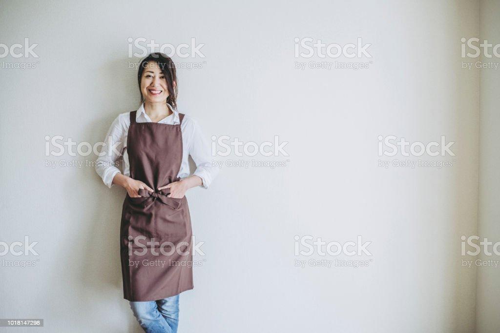 Housewife standing room stock photo