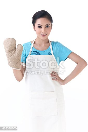 istock housewife standing with kitchen protective glove 482328600