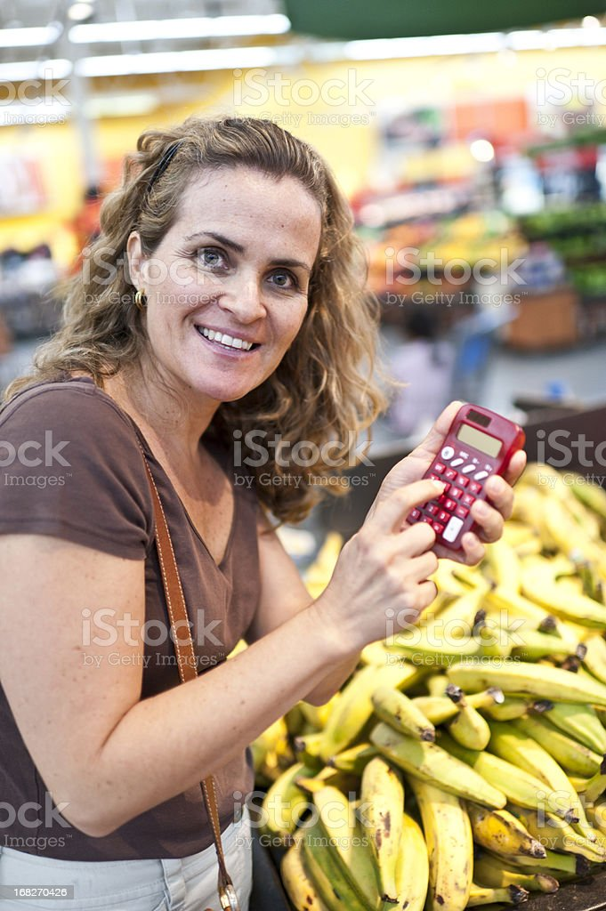 Housewife using a calculator royalty-free stock photo