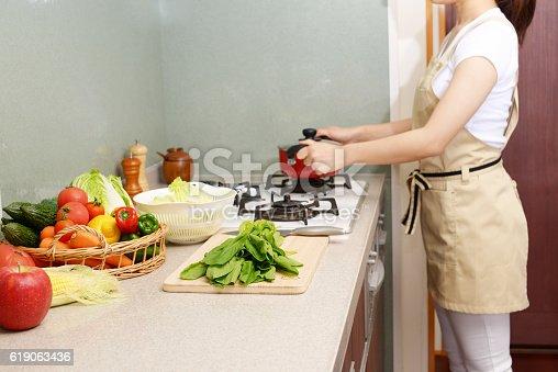 619063596 istock photo Housewife who enjoys cooking 619063436