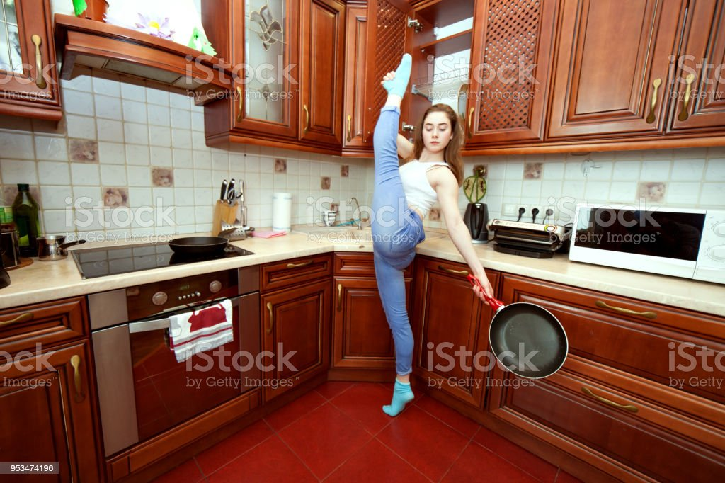 Housewife with a frying pan. stock photo