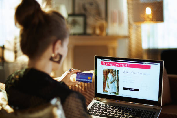 housewife with credit card buying clothes while shop online stock photo