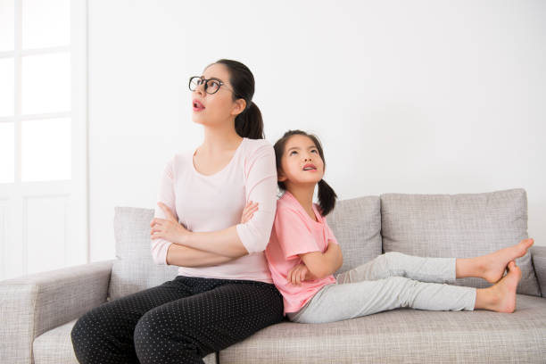 housewife with cute little girl making daydreaming stock photo
