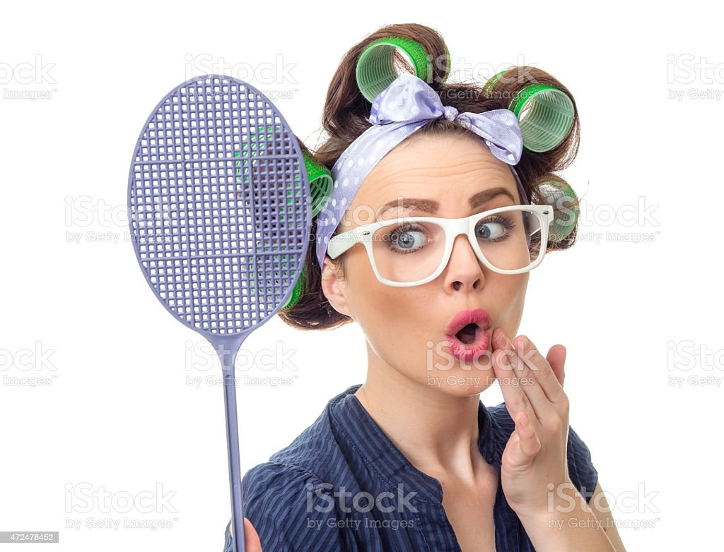 Housewife with fly swatter stock photo