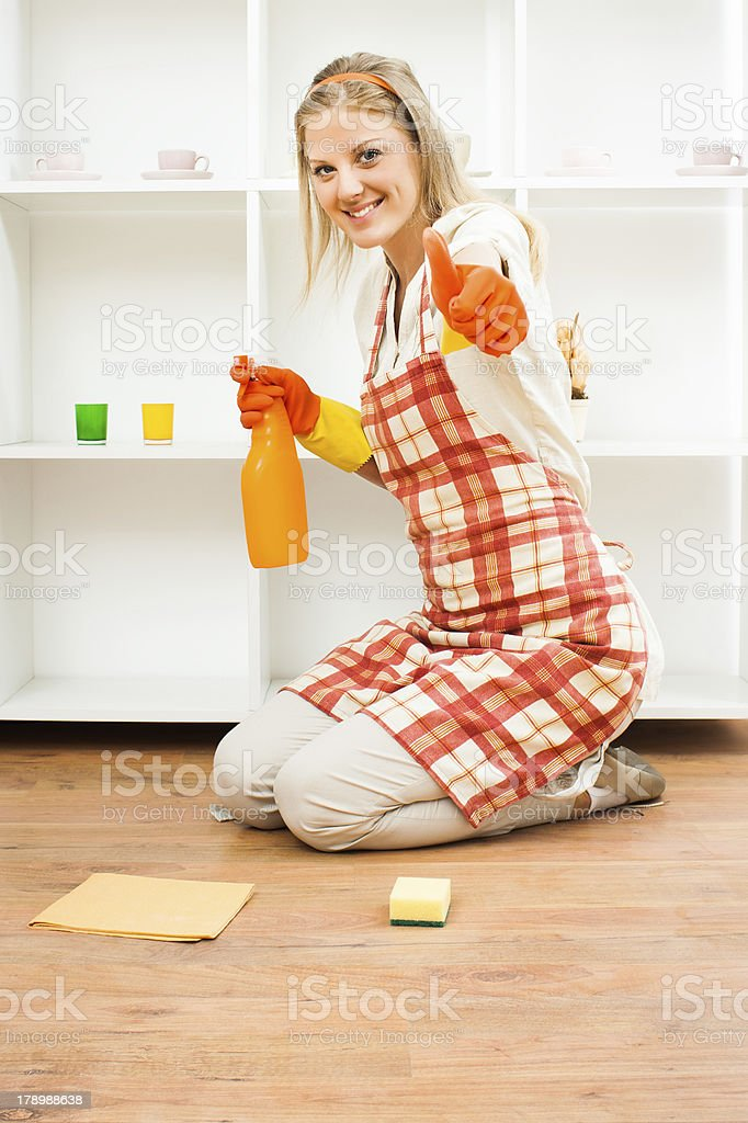 Housewife with her thumb up stock photo