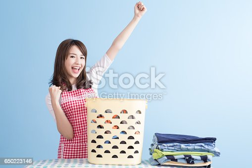 942172234istockphoto housewife with ironing and shirt 650223146