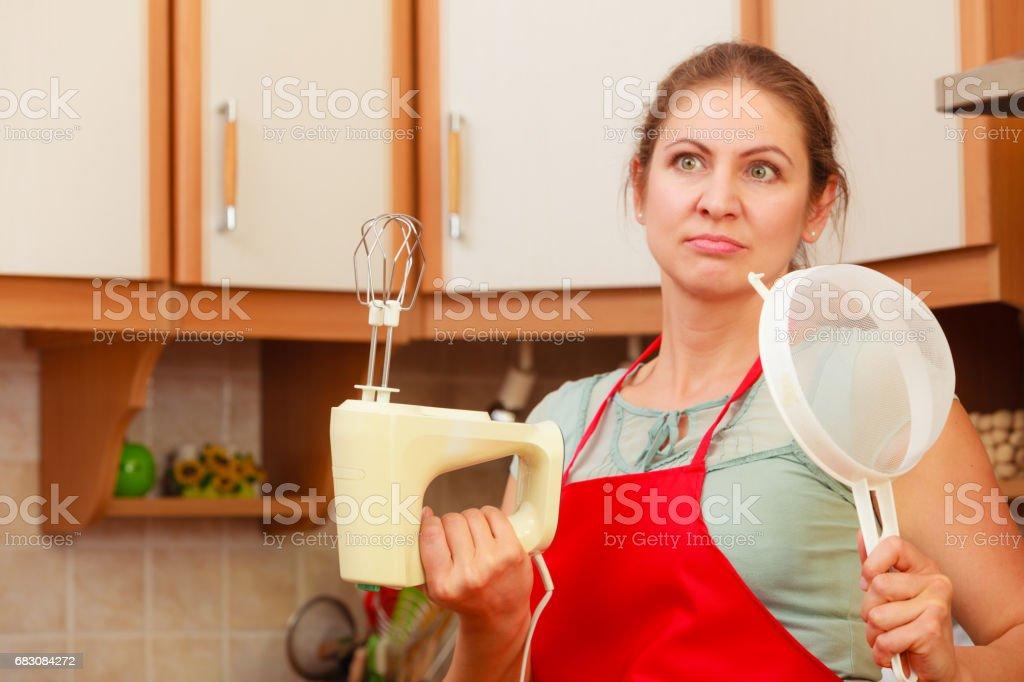 Housewife with mixer having fun in kitchen. zbiór zdjęć royalty-free