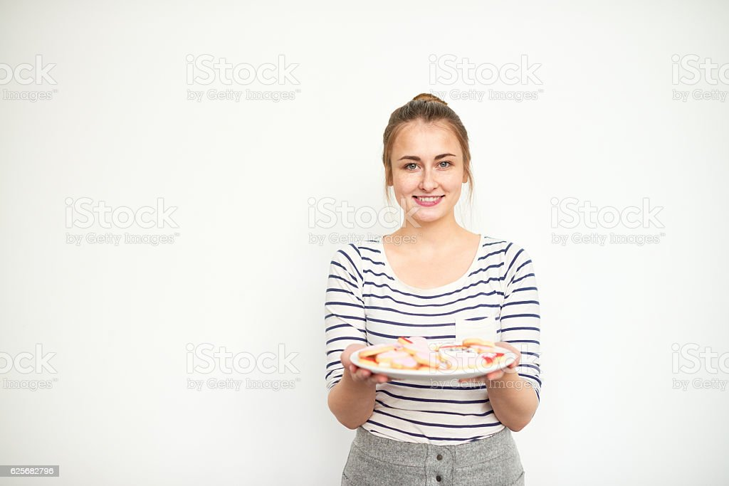 Housewifely woman with treats stock photo