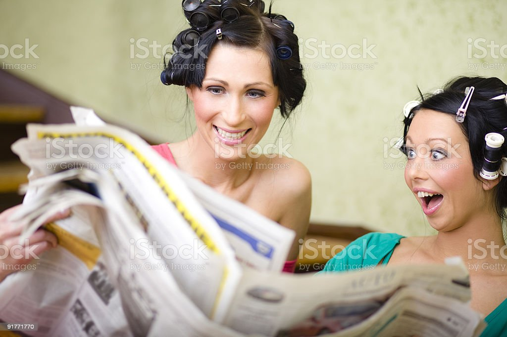 housewives reading newspaper stock photo