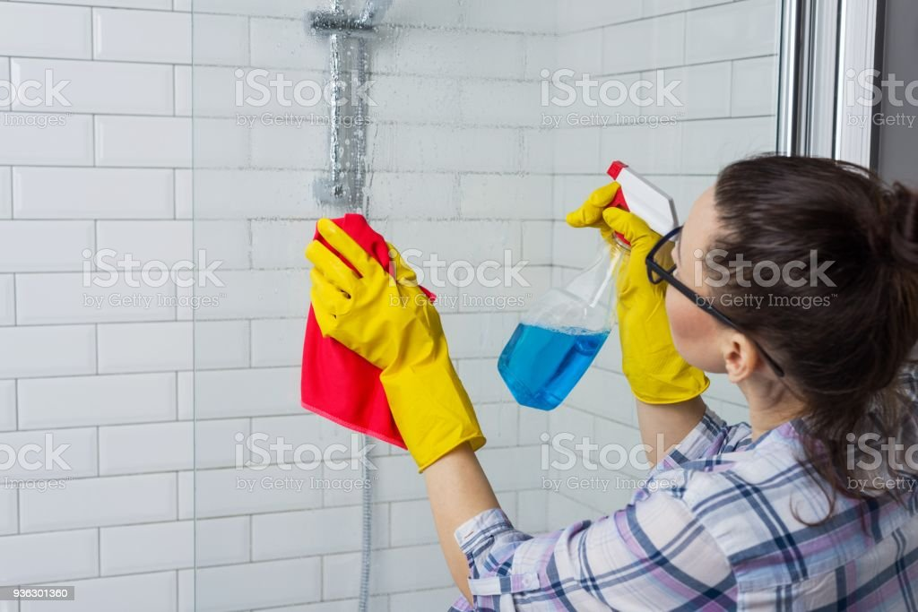 Housework and domestic lifestyle. Woman cleaning bathtub with a cloth Housework and domestic lifestyle. Woman cleaning bathtub with a cloth. Adult Stock Photo