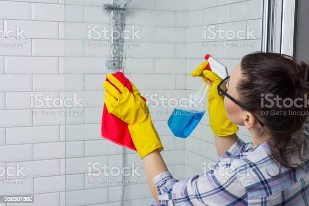 Housework And Domestic Lifestyle Woman Cleaning Bathtub With A Cloth Stock Photo - Download Image Now