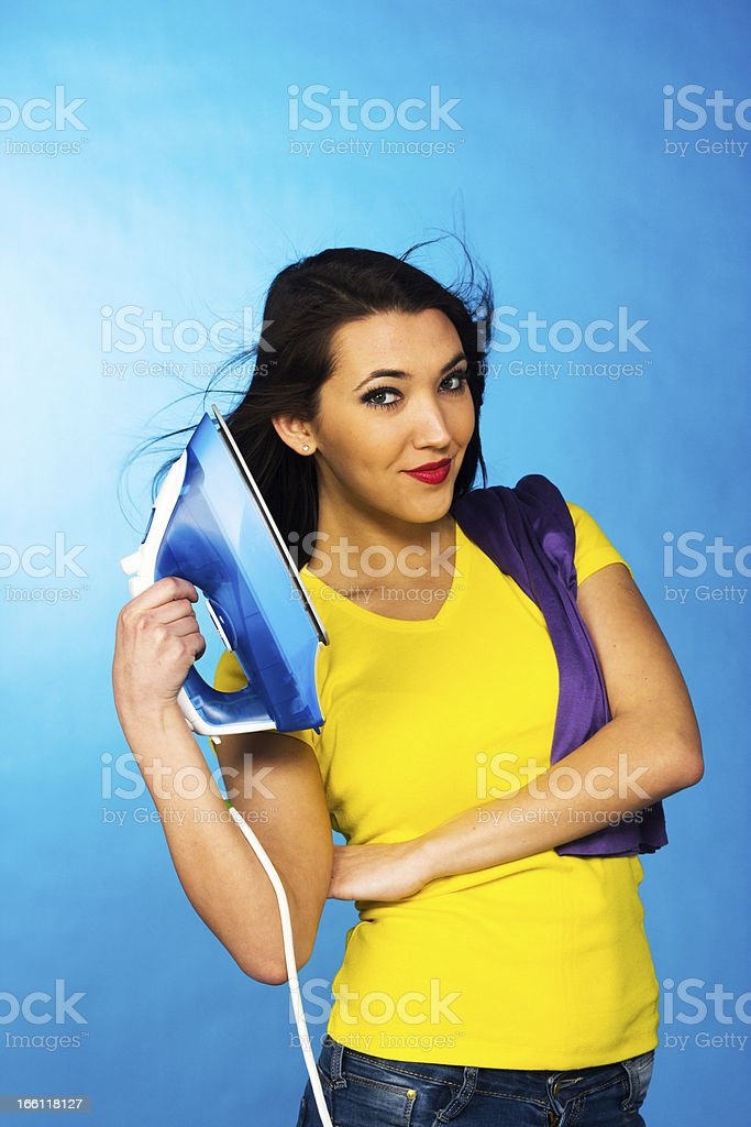 Houseworks, woman with pile of clothes for ironing royalty-free stock photo