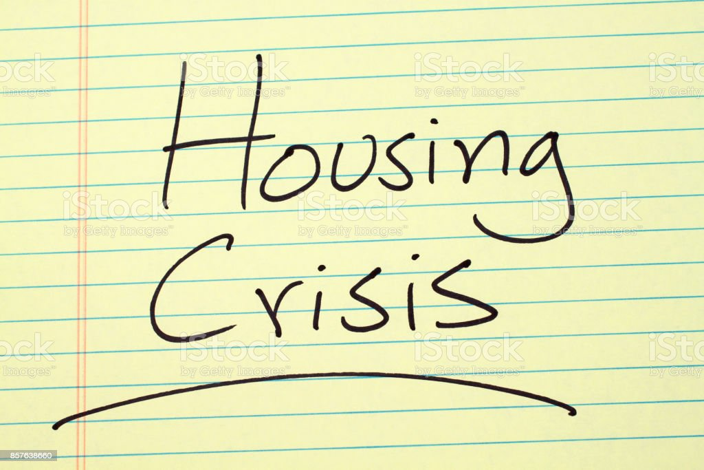 Housing Crisis On A Yellow Legal Pad stock photo