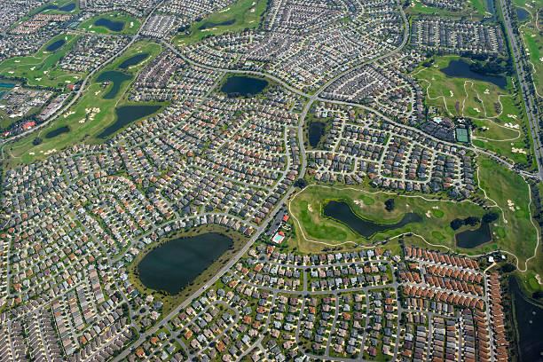 Housing Development Aerial Suburban neighborhood of The Villages, Florida urban sprawl stock pictures, royalty-free photos & images