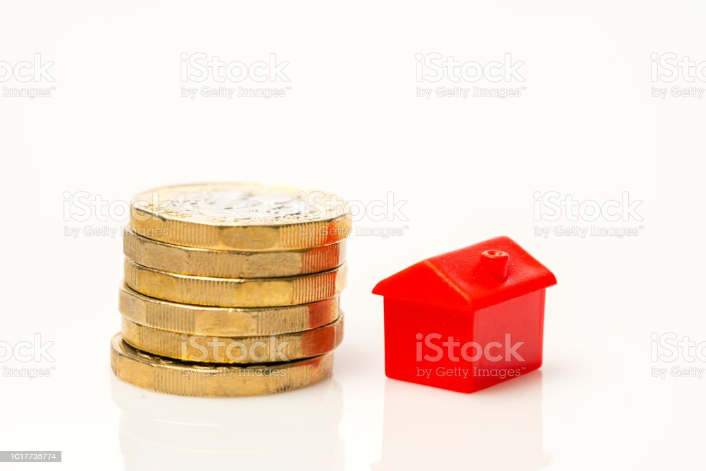 Housing Estate Concept With Coins In Studio Stock Photo - Download