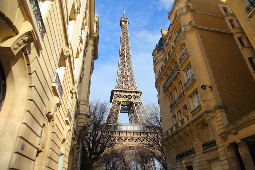 Traditional parisian building near Eiffel tower with very expensive apartments