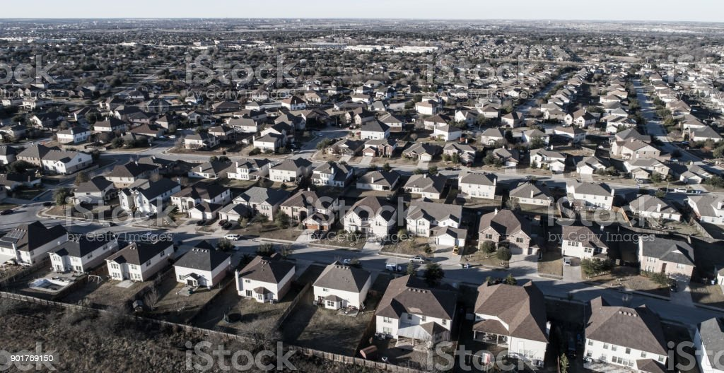 Aerial drone view of homes and houses in suburbia neighborhood in...