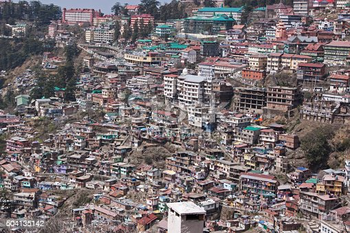 Housing on a densely populated hillside at Shimla in Northern India. Shimla, in the foothills of the Himalayas, was the summer headquarters of the British administration before Indian independence