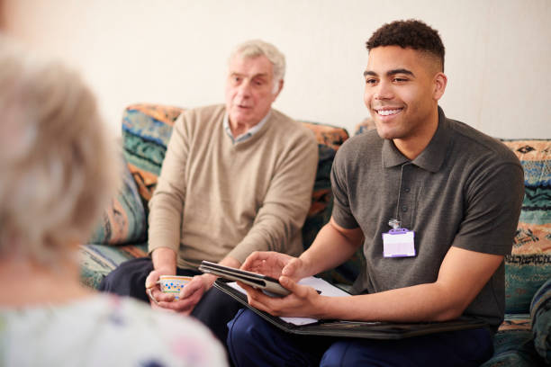 housing support worker with clients stock photo