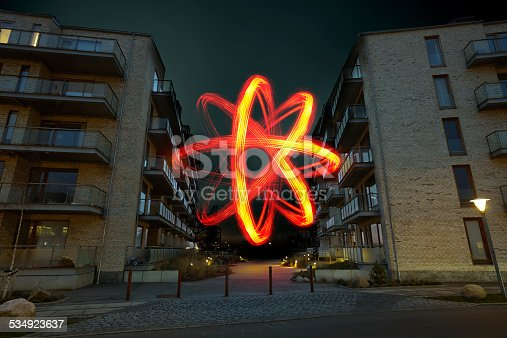 Between the two residences viewed from the side -  in between them there arises a great energy mass / a great light / energy power / red star of light