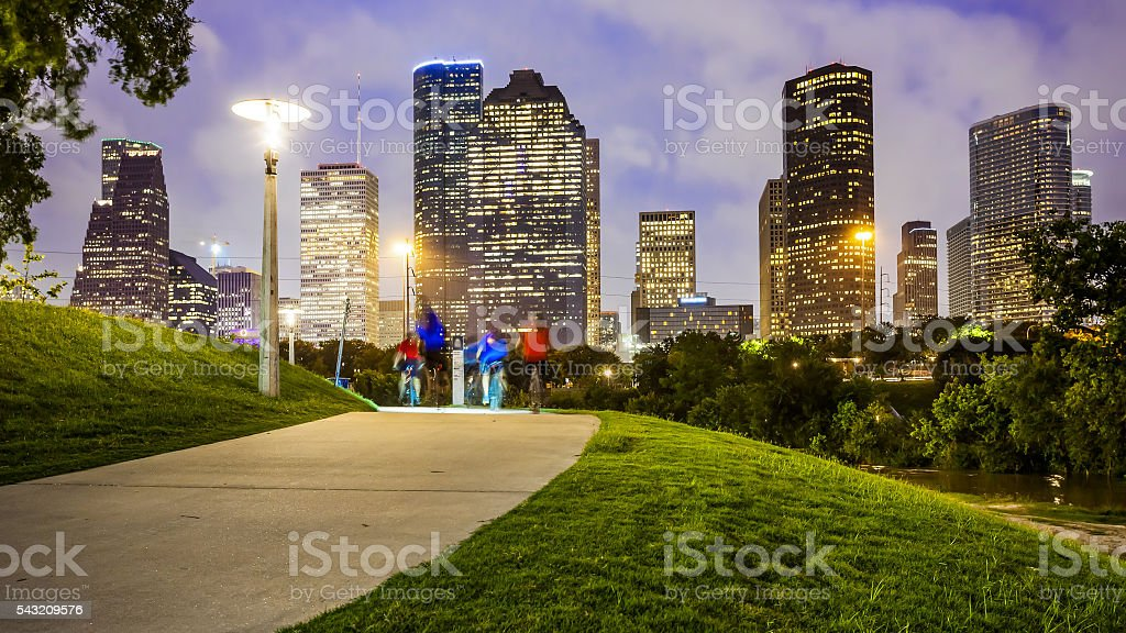 Houston City Skyline at Night & People in Park stock photo