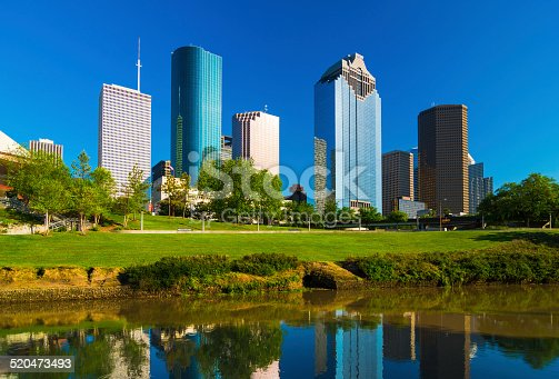 Houston downtown skyscrapers view / skyline view with the Buffalo Bayou River and park in the foreground.