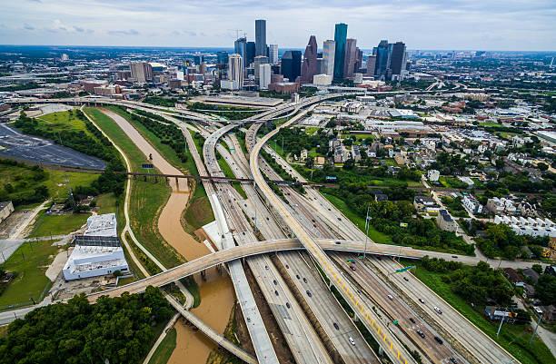 houston texas aerial over passing interchanges cityscape - houston texas stock-fotos und bilder