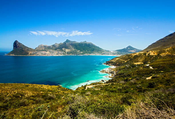 Hout bay beach and Cape of Good Hope, Cape Town, South Africa Panoramic seascape view of Hout bay beach and hills from Cape of Good Hope, Cape Town, South Africa hout stock pictures, royalty-free photos & images