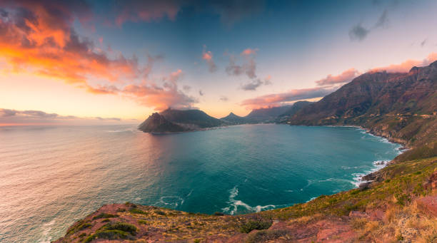 Hout Bay from Chapman's Peak Drive This picture feature Hout Bay as seen from Chapman's Peak Drive at the late afternoon in a somewhat cloudy day. hout stock pictures, royalty-free photos & images