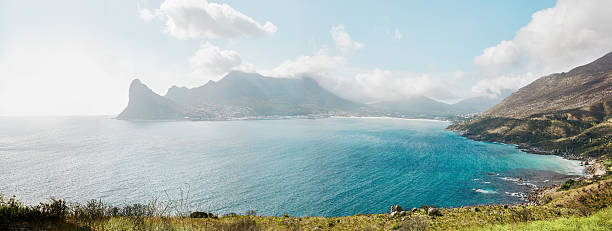 Hout Bay from Chapman's peak Drive, South Africa. Panoramic shot of beautiful Hout Bay from Chapman's peak Drive on atlantic coast of South Africa. Bay of water, mountain range and cloudscapes. hout stock pictures, royalty-free photos & images