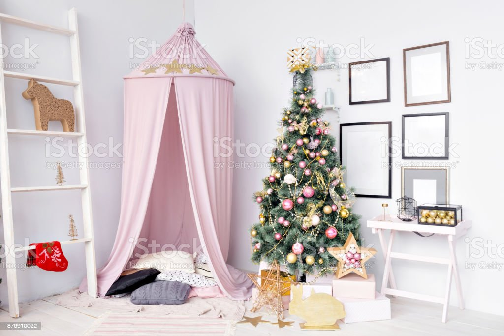 Hovel prepared for children. Beautiful New Year decor of the children room Christmas house. stock photo