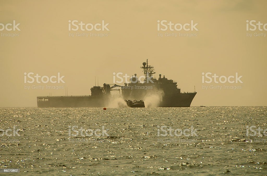 Hovercraft assault from battleship stock photo