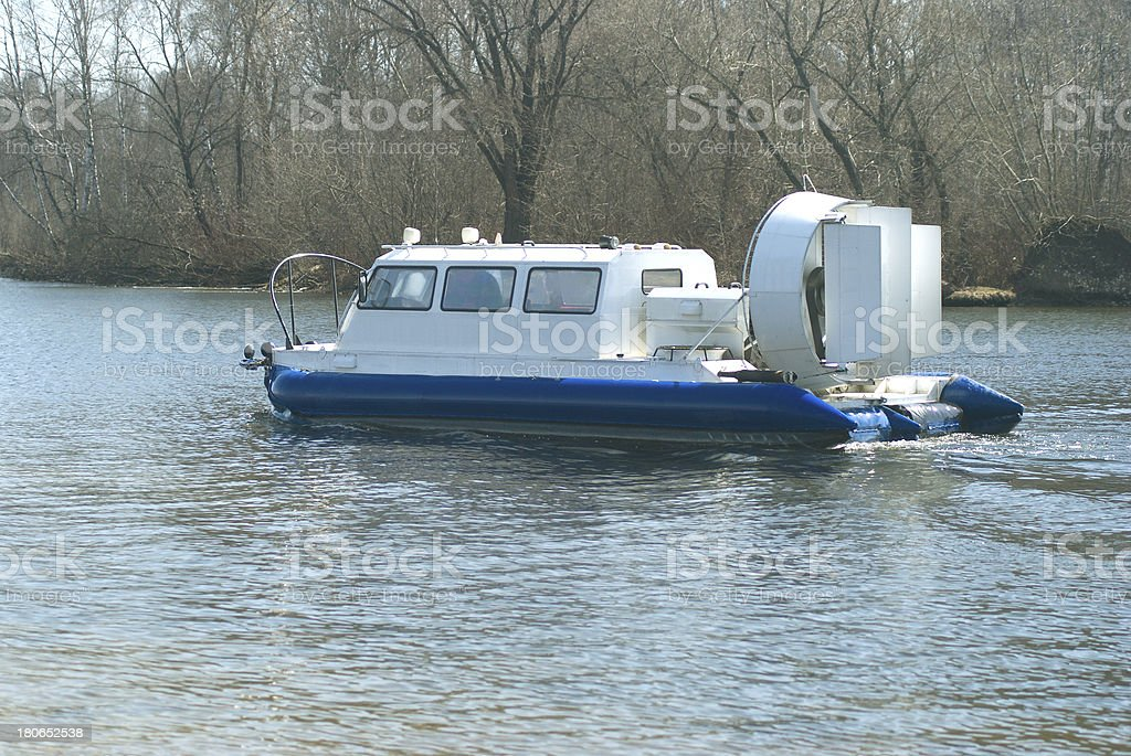 Hovercraft floats on a river stock photo