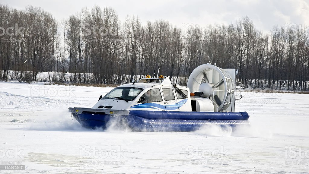 Hovercraft rides on the frozen river stock photo
