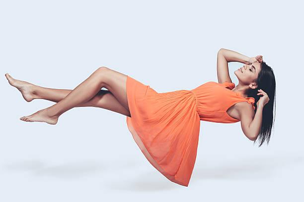 hovering beauty. - levitazione foto e immagini stock