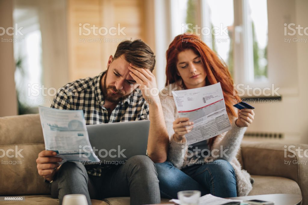 How are we going to pay these bills? stock photo