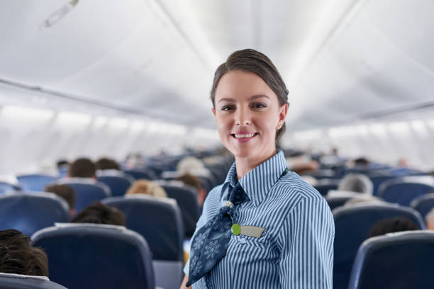 How can I help make your flight a good one? Portrait of a confident young air hostess working on an airplane air stewardess stock pictures, royalty-free photos & images