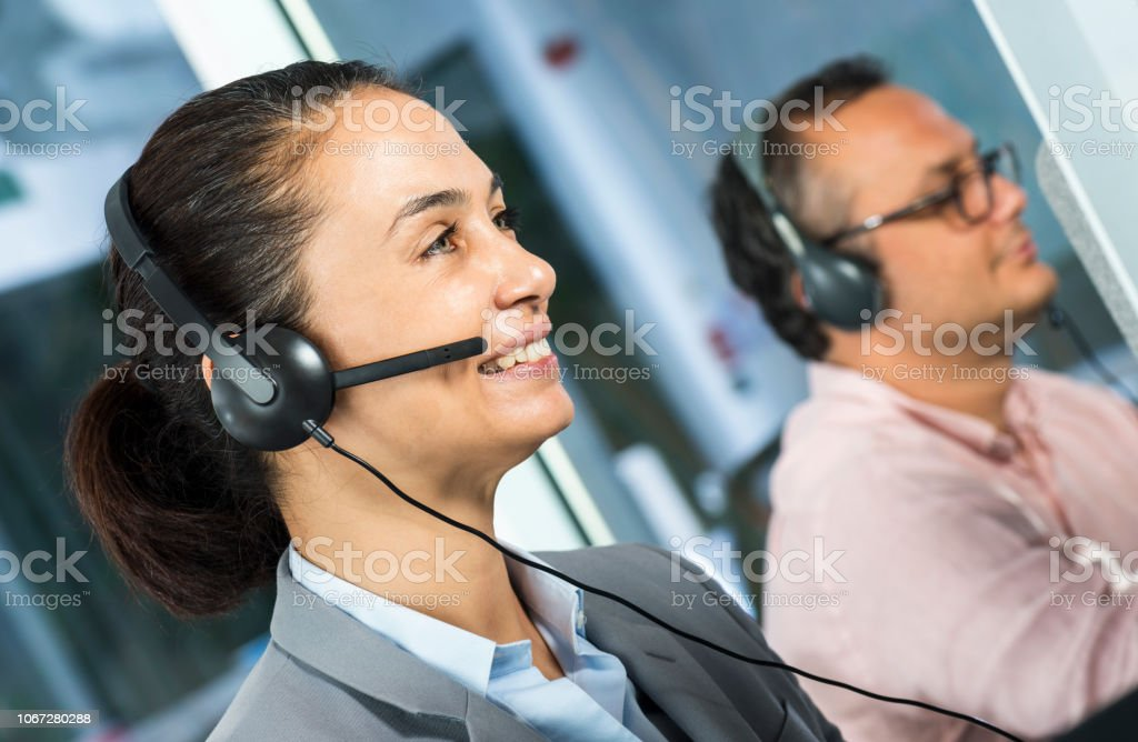 Two call center agent talking with customers.