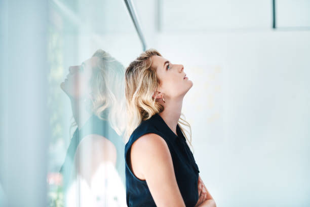How did I manage to mess up so badly today? Shot of a young businesswoman looking stressed out in an office diad stock pictures, royalty-free photos & images