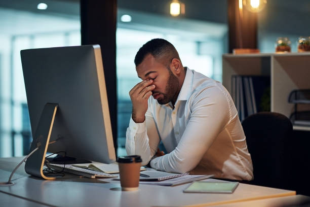 How did I not see this deadline coming? Shot of a young businessman experiencing stress during late night at work mental burnout stock pictures, royalty-free photos & images