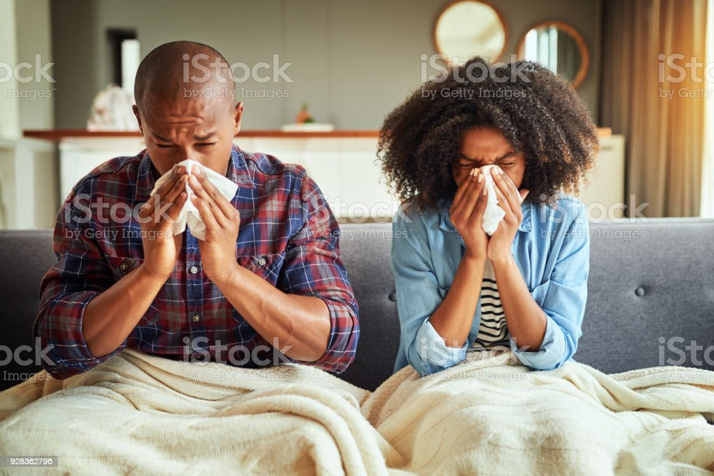 How did we both get sick? stock photo
