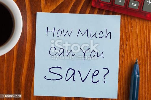 How Much Can You Save written on note with pen a side, cup of coffee and calculator.