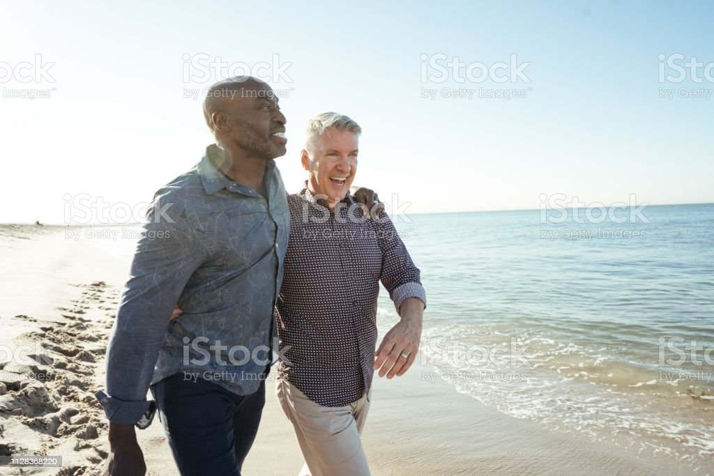 how much to save for retirement Senior couple on the beach Active Seniors Stock Photo
