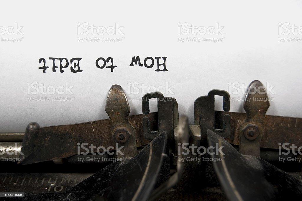 How to Edit upside down on vintage typewriter stock photo
