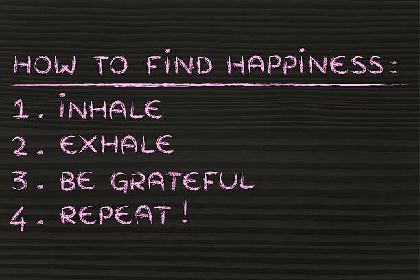 How to find happiness list: inhale, exhale, be grateful stock photo