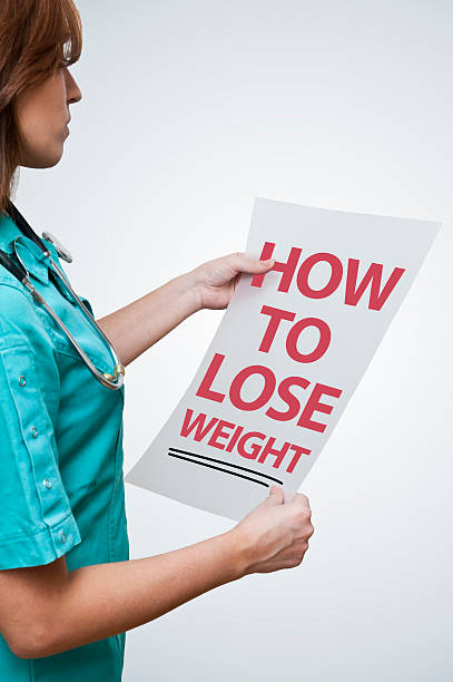 how to lose weight (click for more) - question mark asking doctor nurse stock photos and pictures
