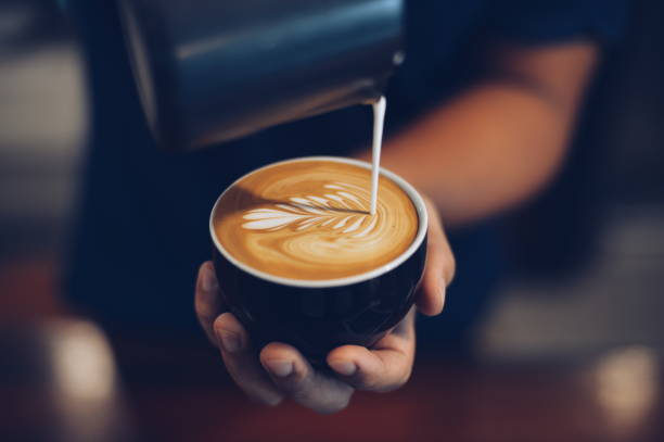 how to make coffee latte art how to make coffee latte art barista stock pictures, royalty-free photos & images