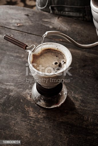 Barista showing different types of Brewed Coffee